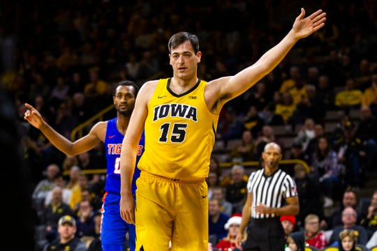 Iowa center Ryan Kriener gestures that possession of the basketball belongs to the Hawkeyes during a Dec. 22 win over Savannah State. The junior figures to get extended minutes against Bryant on Saturday while starter Luka Garza sits out with an ankle injury.