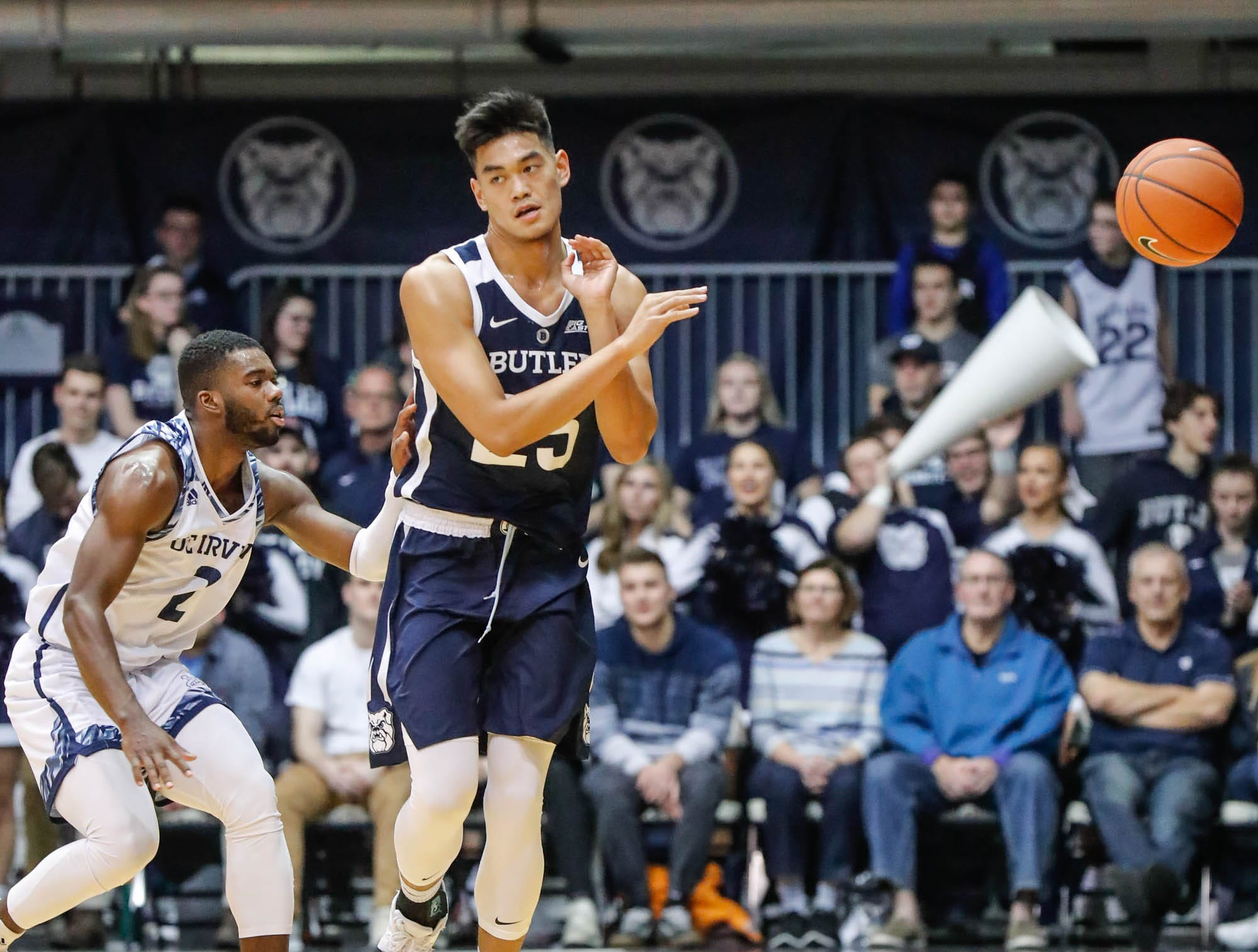 Butler University's forward Christian David (25), passes the ball during a game between Butler University and UC Irvine, at Hinkle Fieldhouse on Friday, Dec. 21, 2018. UC Irvines's guard Max Hazzard (2).