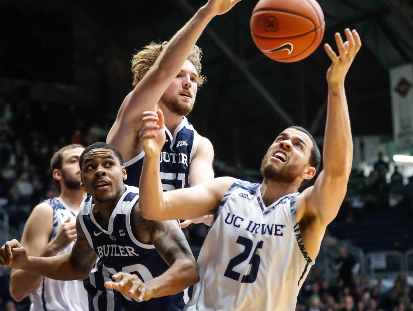 Butler University's center Joey Brunk (50), guard/forward Henry Baddley (20), and UC Irvine's guard Spencer Rivers (25) leap for a rebound during a game between Butler University and UC Irvine, at Hinkle Fieldhouse on Friday, Dec. 21, 2018.