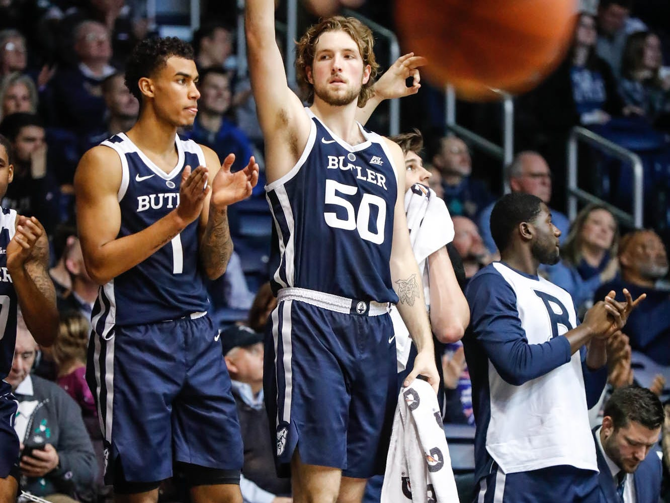Butler University's forward Jordan Tucker (1), and Joey Brunk (50), cheer on team mates during a game between Butler University and UC Irvine, at Hinkle Fieldhouse on Friday, Dec. 21, 2018.
