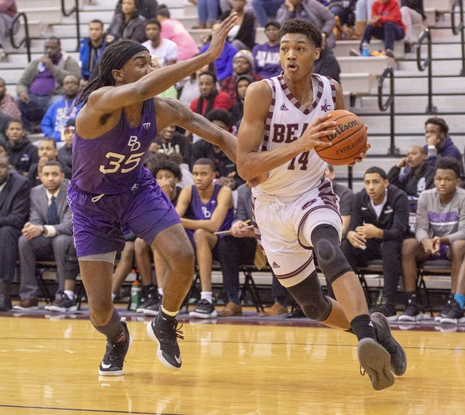 Lawrence Central High School junior Dre Davis (14) races the ball along the baseline during the first half of action. Lawrence Central High School hosted Ben Davis High School in IHSAA varsity basketball action, Friday, Dec. 21, 2018.