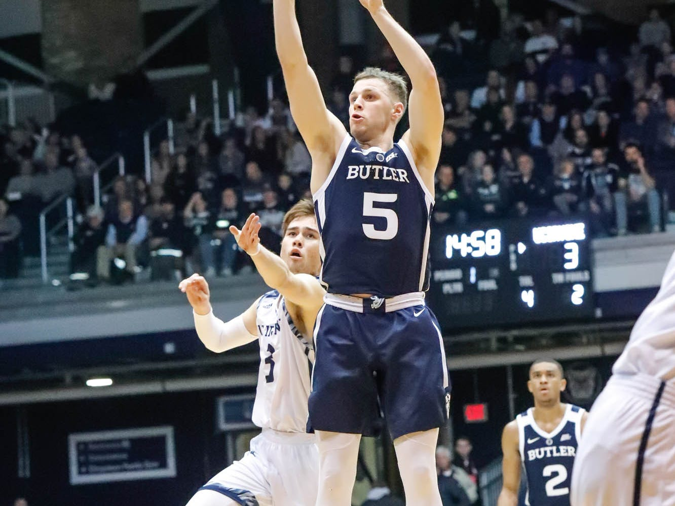 Butler University's guard Paul Jorgensen (5) hits a three point shot against UC Irvine's guard Robert Cartwright (3), during a game between Butler University and UC Irvine, at Hinkle Fieldhouse on Friday, Dec. 21, 2018.
