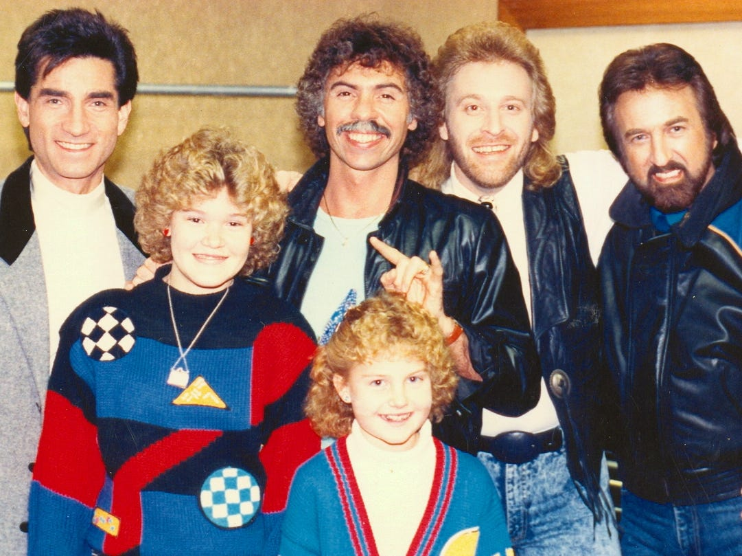 Richard Sterban, Joe Bonsall, Steve Sanders and Duane Allen of The Oak Ridge Boys backstage in Merrillville, Indiana, with Ginger Rough and her sister, Kristy, in the mid-to-late 1980s.
