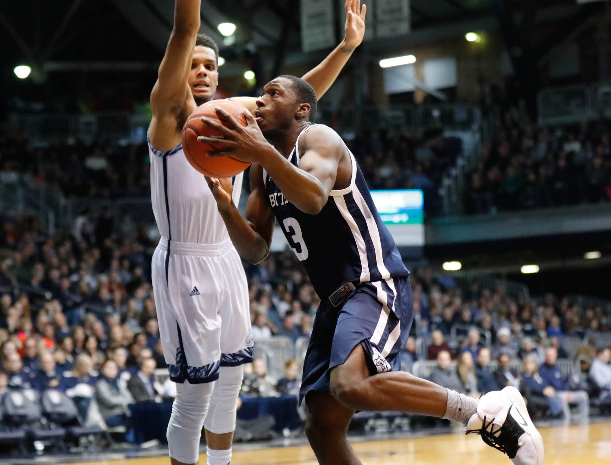 Butler University's guard Kamar Baldwin (3) drives past UC Irvine's guard Evan Leonard (14) for a layup, during a game between Butler University and UC Irvine, at Hinkle Fieldhouse on Friday, Dec. 21, 2018.