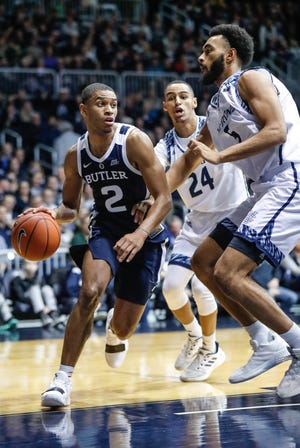 Butler University's guard Aaron Thompson (2), drives past UC Irvine's forward Elston Jones (50), and UC Irvine's guard Eyassu Worku (24), during a game between Butler University and UC Irvine, at Hinkle Fieldhouse on Friday, Dec. 21, 2018.