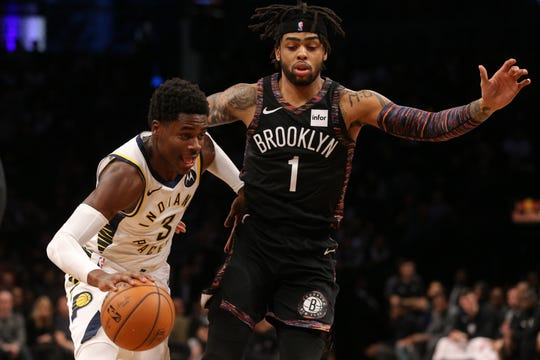 Dec 21, 2018; Brooklyn, NY, USA; Indiana Pacers point guard Aaron Holiday (3) plays the ball against Brooklyn Nets point guard D'Angelo Russell (1) during the second quarter at Barclays Center.