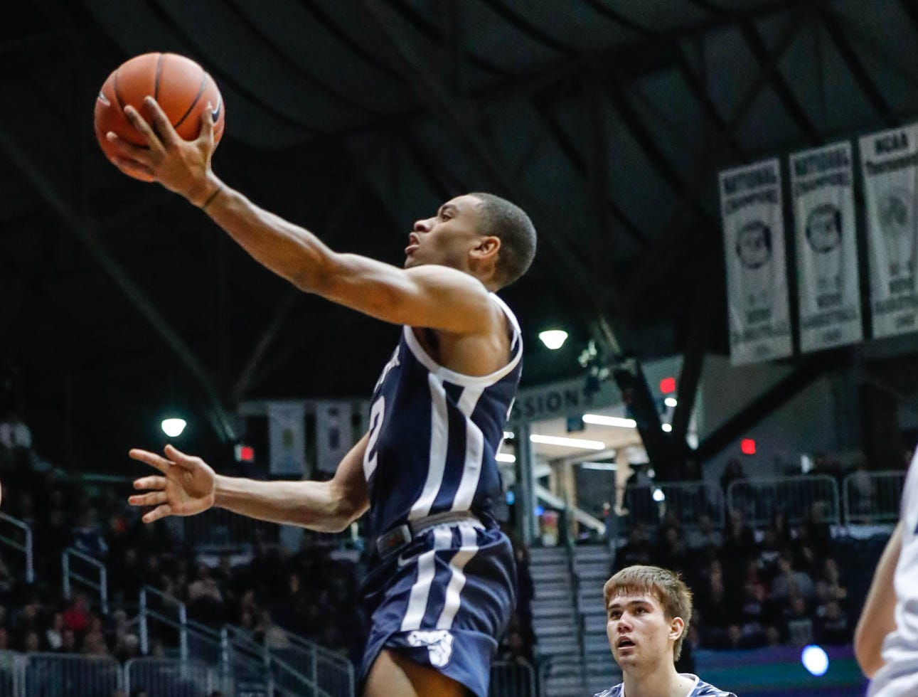 Butler University's guard Aaron Thompson (2), shoots a layup past UC Irvine's guard Max Hazzard (2), during a game between Butler University and UC Irvine, at Hinkle Fieldhouse on Friday, Dec. 21, 2018.