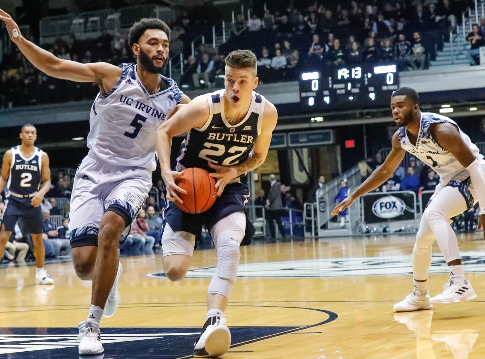 Butler University's forward Sean McDermott (22), drives toward the basket during a fast break past UC Irvine's forward Jonathan Galloway (5), during a game between Butler University and UC Irvine, at Hinkle Fieldhouse on Friday, Dec. 21, 2018.