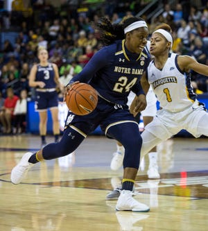 Notre Dame's Arike Ogunbowale, left, drives to the basket against Marquette's Danielle King, right, during the first half of an NCAA women's college basketball game Saturday, Dec. 22, 2018, in Milwaukee.