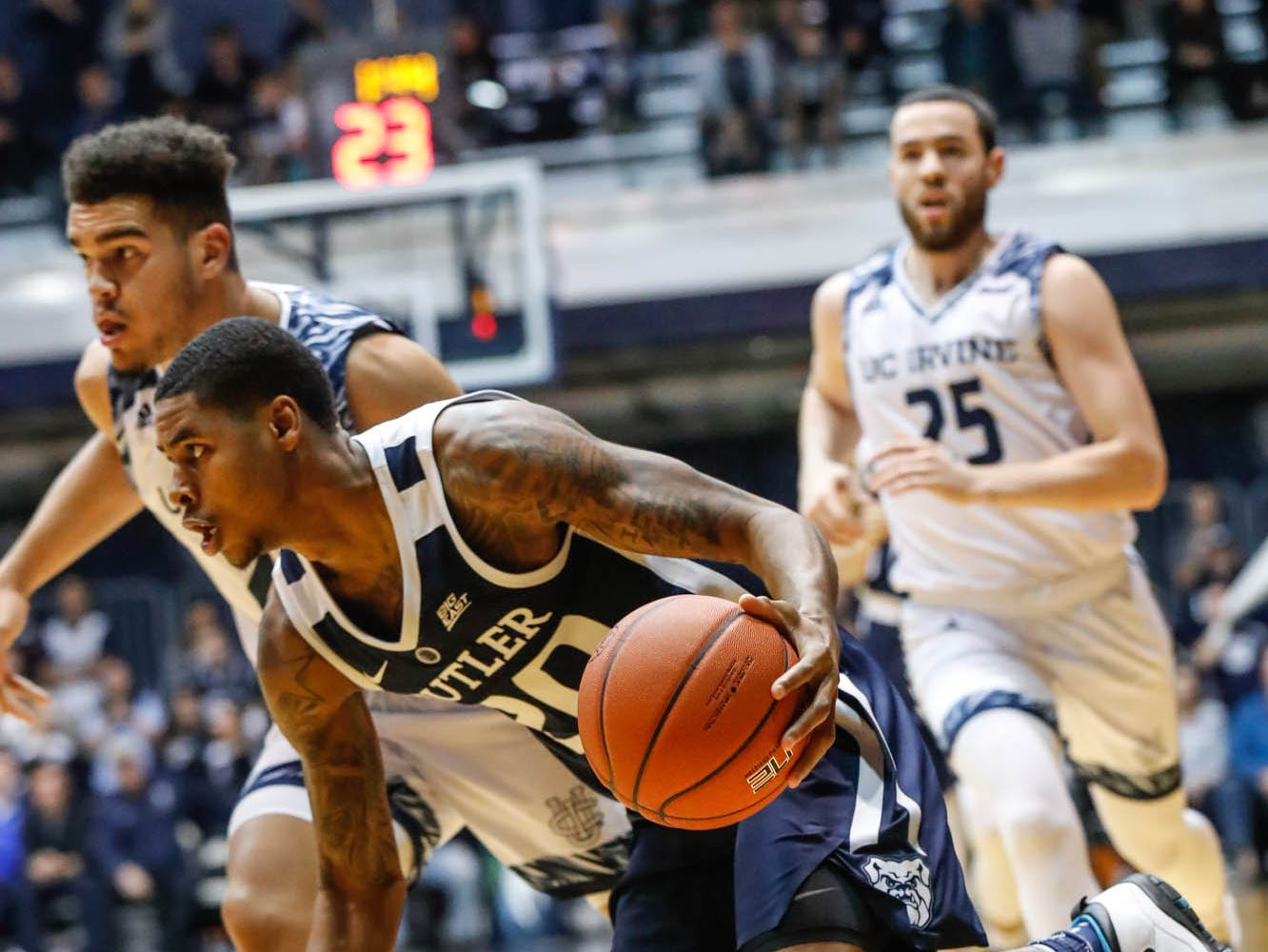 Butler University's guard/forward Henry Baddley (20) drives past opposing players during a game between Butler University and UC Irvine, at Hinkle Fieldhouse on Friday, Dec. 21, 2018.
