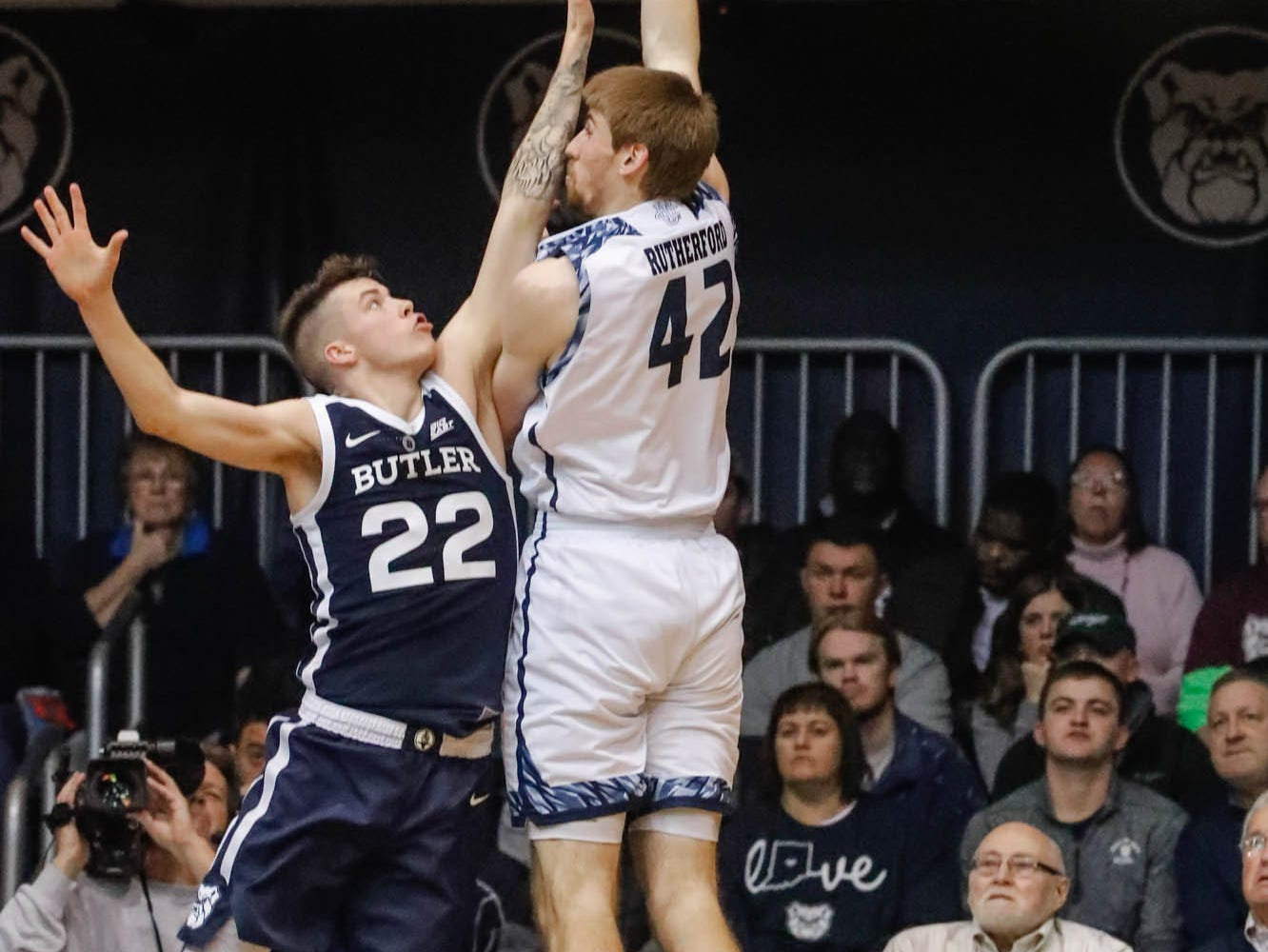 UC Irvine's forward Tommy Rutherford (42) shoots a hook shot over Butler University's forward Sean McDermott (22), during a game between Butler University and UC Irvine, at Hinkle Fieldhouse on Friday, Dec. 21, 2018.