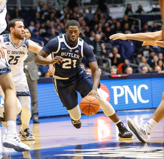 Butler University's guard/forward Jerald Gillens-Butler (21) drives past UC Irvine's guard Spencer Rivers (25) to the lane during a game between Butler University and UC Irvine, at Hinkle Fieldhouse on Friday, Dec. 21, 2018.