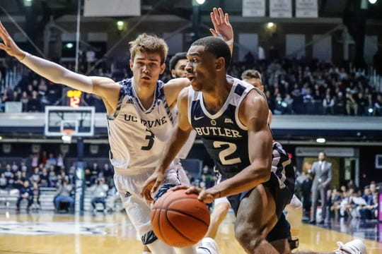 Butler University's guard Aaron Thompson (2) drives past UC Irvine's guard Robert Cartwright (3), during a game between Butler University and UC Irvine, at Hinkle Fieldhouse on Friday, Dec. 21, 2018.