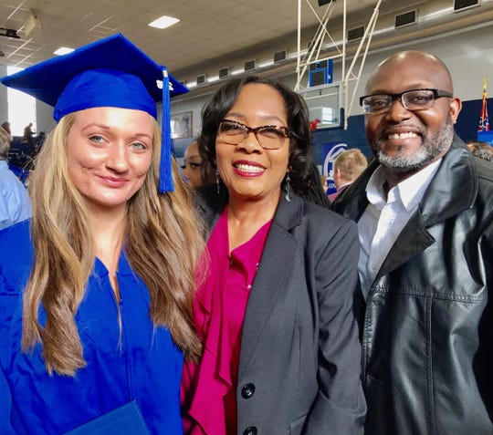 Tiffany Clemmens, left, graduated from Copiah-Lincoln Community College on Dec. 12. After years of battling drug addiction, Clemmens says Stephanie Turner, center, and husband Johnny Turner helped save her life. The Turners run Doll's House in Brookhaven, a mission home for abused or homeless women.