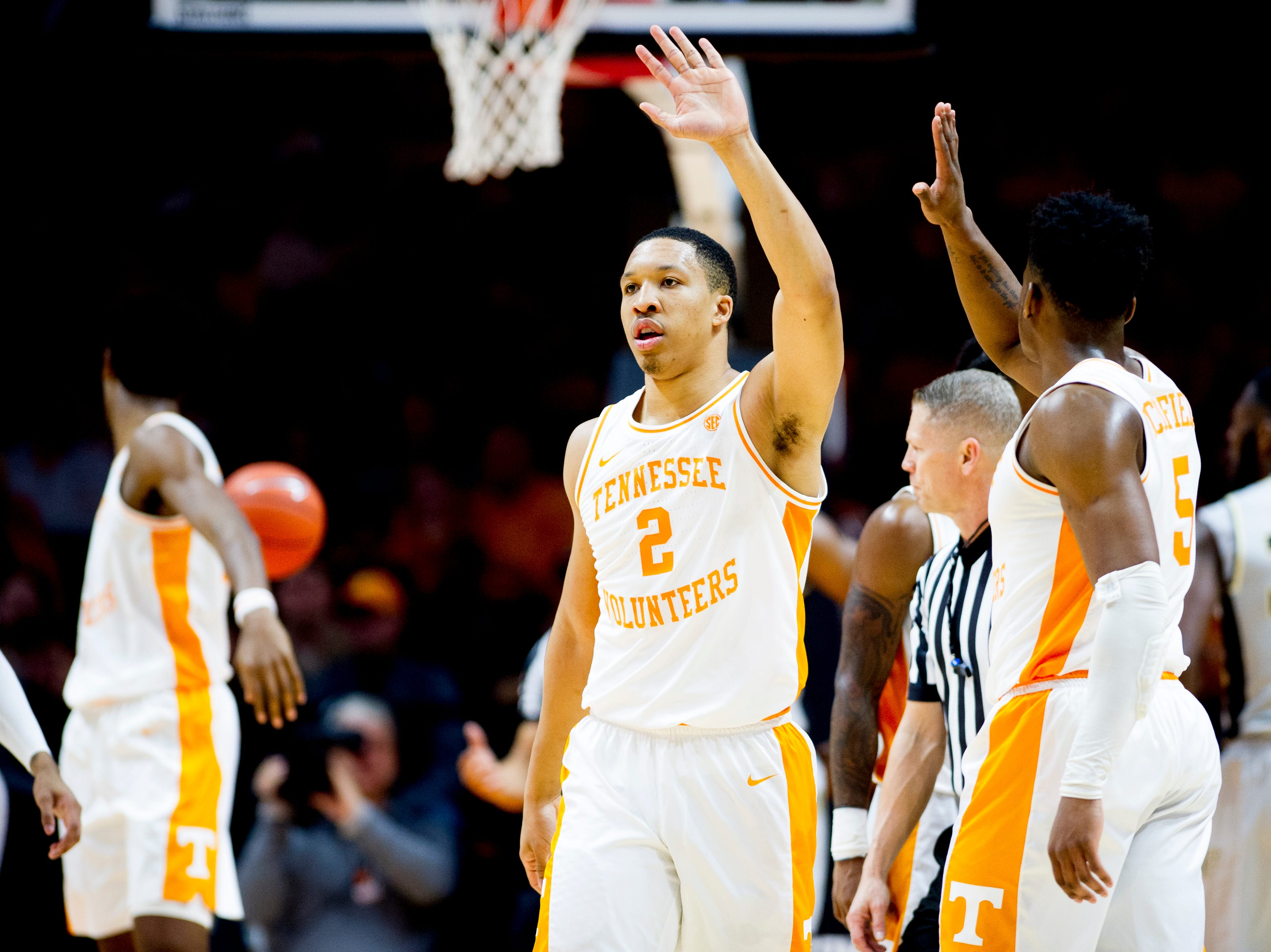 Tennessee forward Grant Williams (2) high-fives Tennessee guard Admiral Schofield (5) after making a point during a game between Tennessee and Wake Forest at Thompson-Boling Arena in Knoxville, Tennessee on Saturday, December 22, 2018.