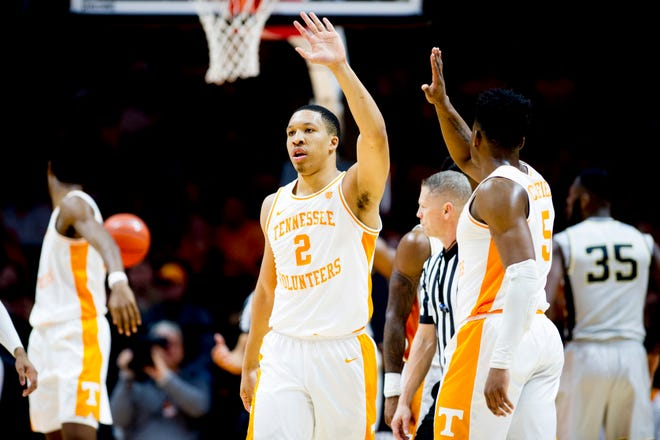 Tennessee forward Grant Williams (2) high-fives guard Admiral Schofield (5) after scoring against Wake Forest on Saturday.