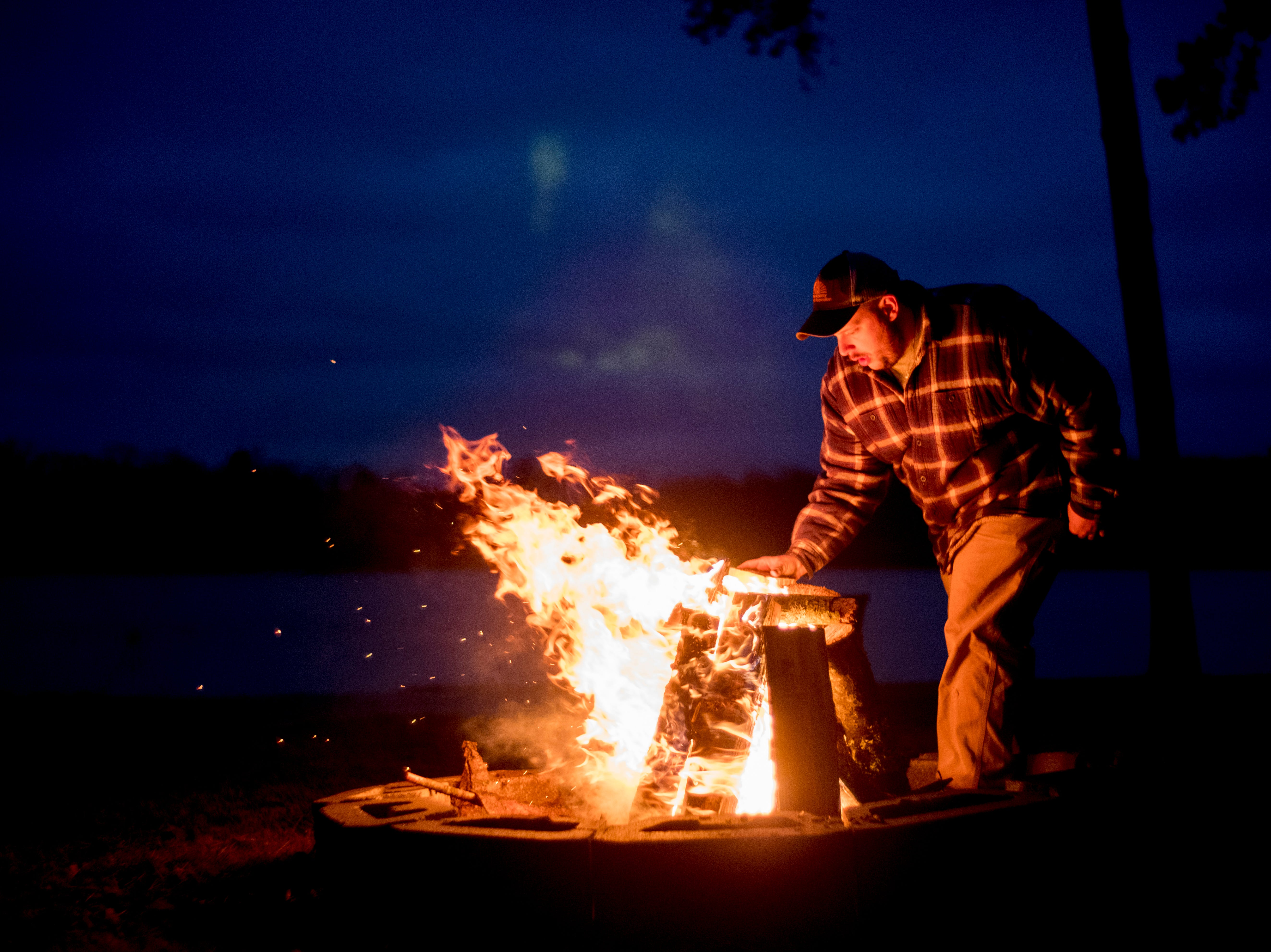 Josh Conaway, with Knox County Parks and Recreation, builds a bonfire at Knox CountyÕs 20th annual Holiday Festival of Lights kick off at The Cove at Concord Park in Farragut, Tennessee on Friday, December 21, 2018. The family-friendly event is free and will run through Dec. 29 from 6 to 9 p.m., excluding Christmas Eve and Christmas Day.