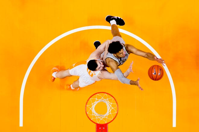 Tennessee forward John Fulkerson (10) and Wake Forest center Olivier Sara (30) go for a rebound during a game between Tennessee and Wake Forest at Thompson-Boling Arena in Knoxville, Tennessee on Saturday, December 22, 2018.