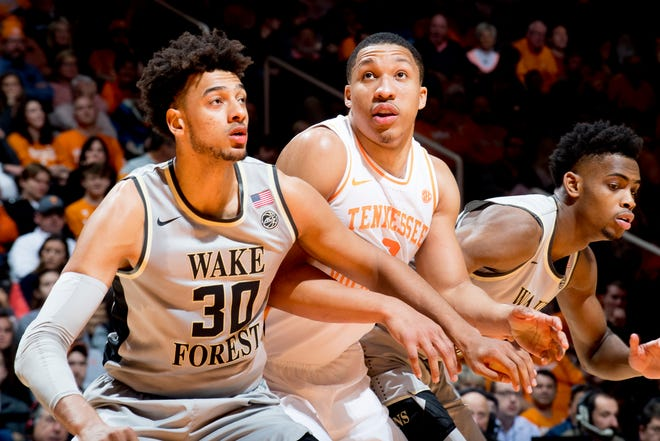 Tennessee forward Grant Williams, middle, goes for a rebound against Wake Forest on Dec. 22. The Vols are ranked No. 3 in the latest AP poll.