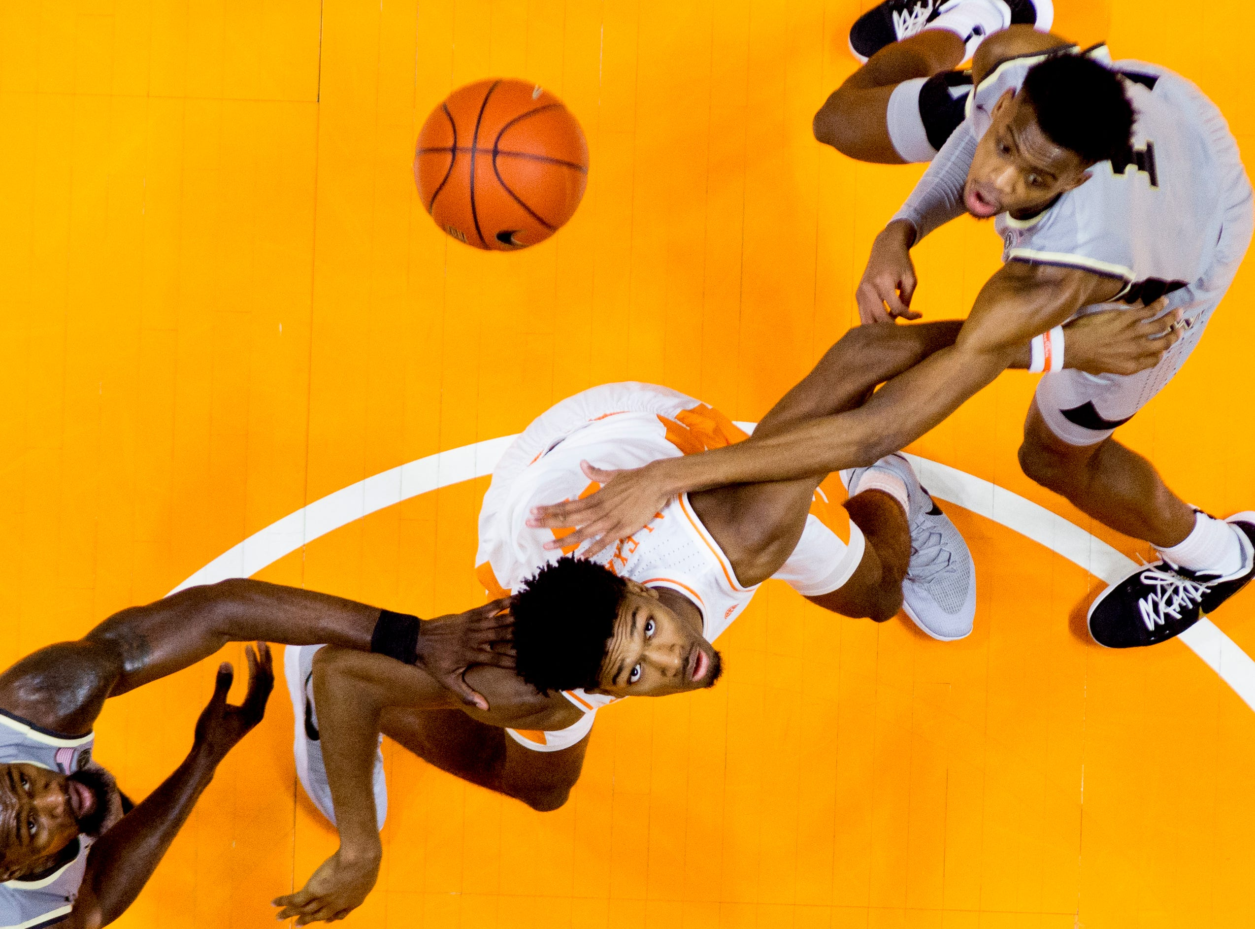 Tennessee forward Kyle Alexander (11) eyes a loose ball during a game between Tennessee and Wake Forest at Thompson-Boling Arena in Knoxville, Tennessee on Saturday, December 22, 2018.