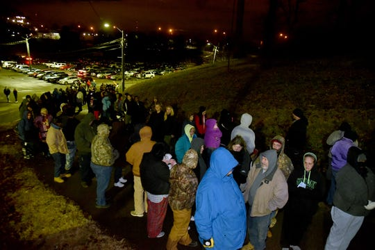 The line for baskets stretches down the hill for Empty Stocking Fund baskets at Chilhowee Park on Saturday, December 22, 2018.