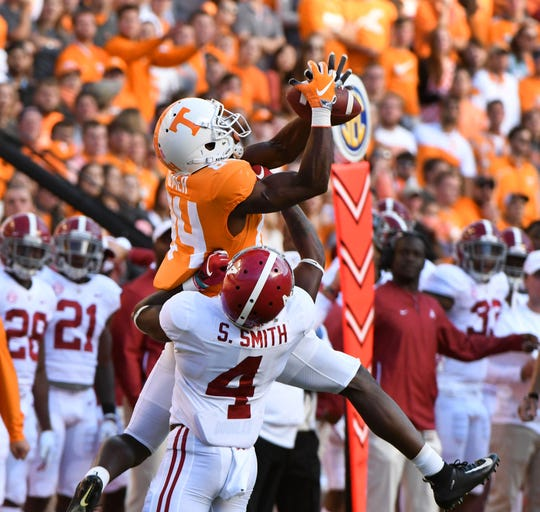 Tennessee wide receiver Josh Palmer (84) completes the catch against Alabama linebacker Christopher Allen (4)during first half action Saturday, October 20, 2018 at Neyland Stadium in Knoxville, Tenn.