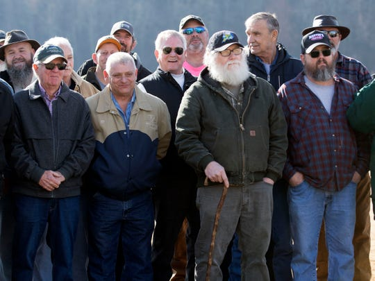 Workers who cleaned up the TVA Kingston Fossil Plant coal ash spill gather for a group photo at the Swan Pond Sports Complex on Saturday.