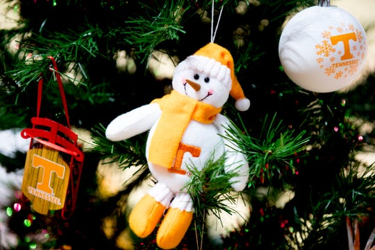 A Vol snowman decoration hangs on a Christmas tree on the court during a game between Tennessee and Wake Forest at Thompson-Boling Arena in Knoxville, Tennessee on Saturday, December 22, 2018.