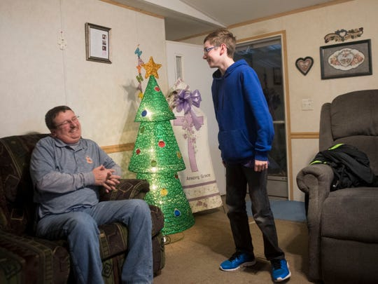 "Randy ""Rooster"" Atkins and son Nathan share a moment of laughter at their home on Monday, December 10, 2018."