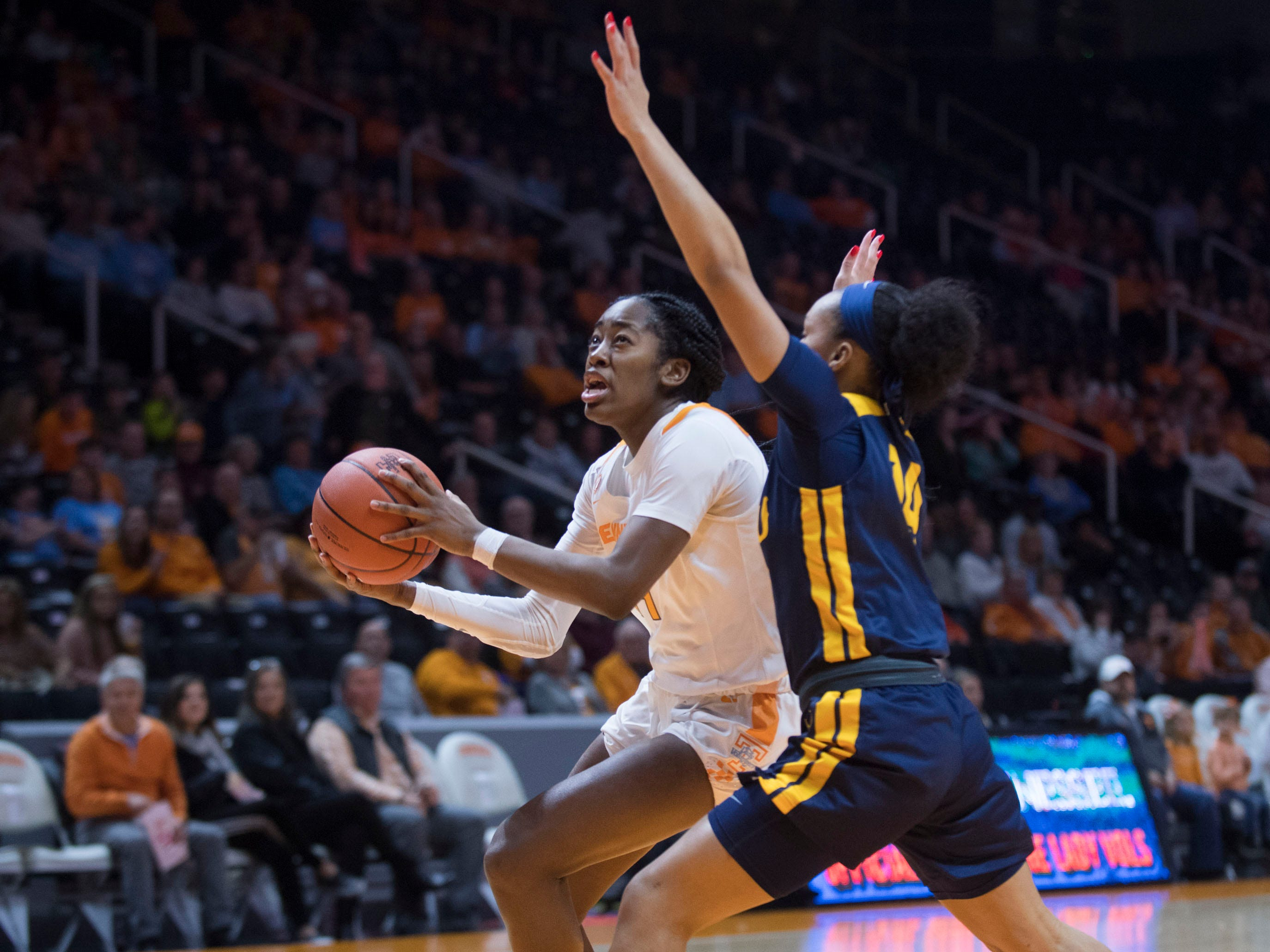 Tennessee's Zaay Green (14) looks to the basket while defended by ETSU's Kaia Upton (14) on Friday, December 21, 2018.