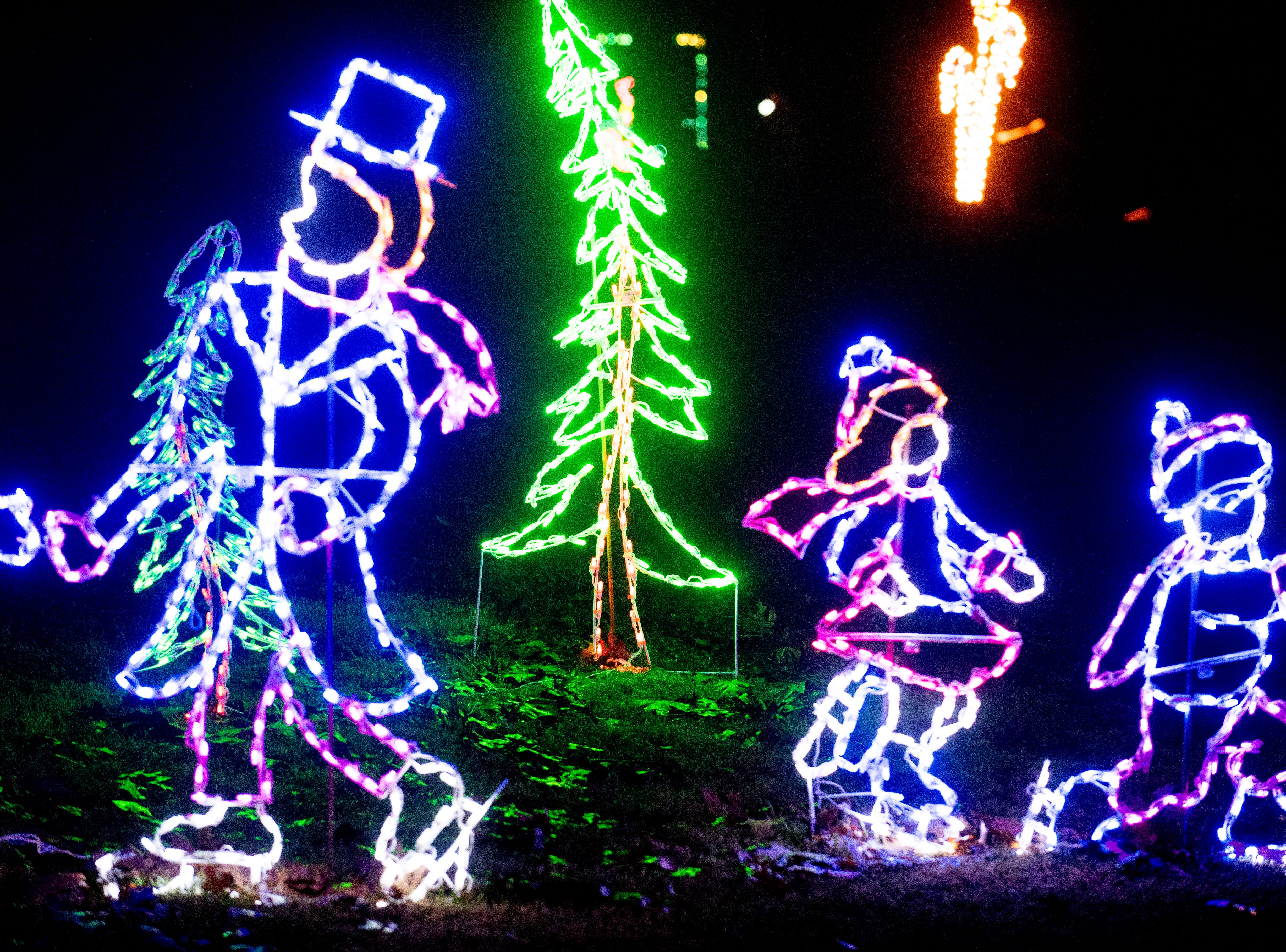 Holiday light decorations in the form of people ice skating at Knox CountyÕs 20th annual Holiday Festival of Lights kick off at The Cove at Concord Park in Farragut, Tennessee on Friday, December 21, 2018. The family-friendly event is free and will run through Dec. 29 from 6 to 9 p.m., excluding Christmas Eve and Christmas Day.