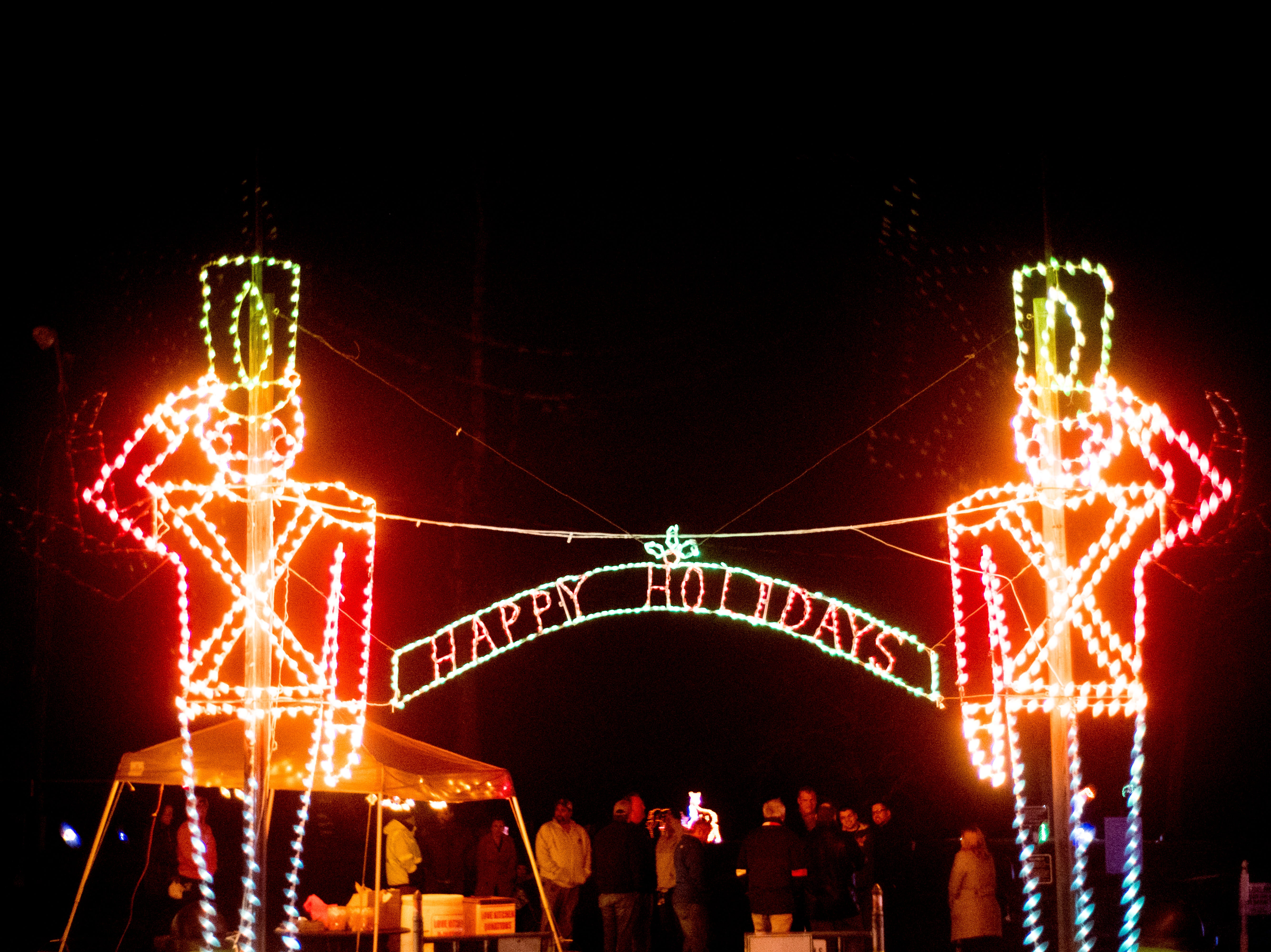 """Happy Holidays"" reads a greeting above the entrance at Knox CountyÕs 20th annual Holiday Festival of Lights kick off at The Cove at Concord Park in Farragut, Tennessee on Friday, December 21, 2018. The family-friendly event is free and will run through Dec. 29 from 6 to 9 p.m., excluding Christmas Eve and Christmas Day."