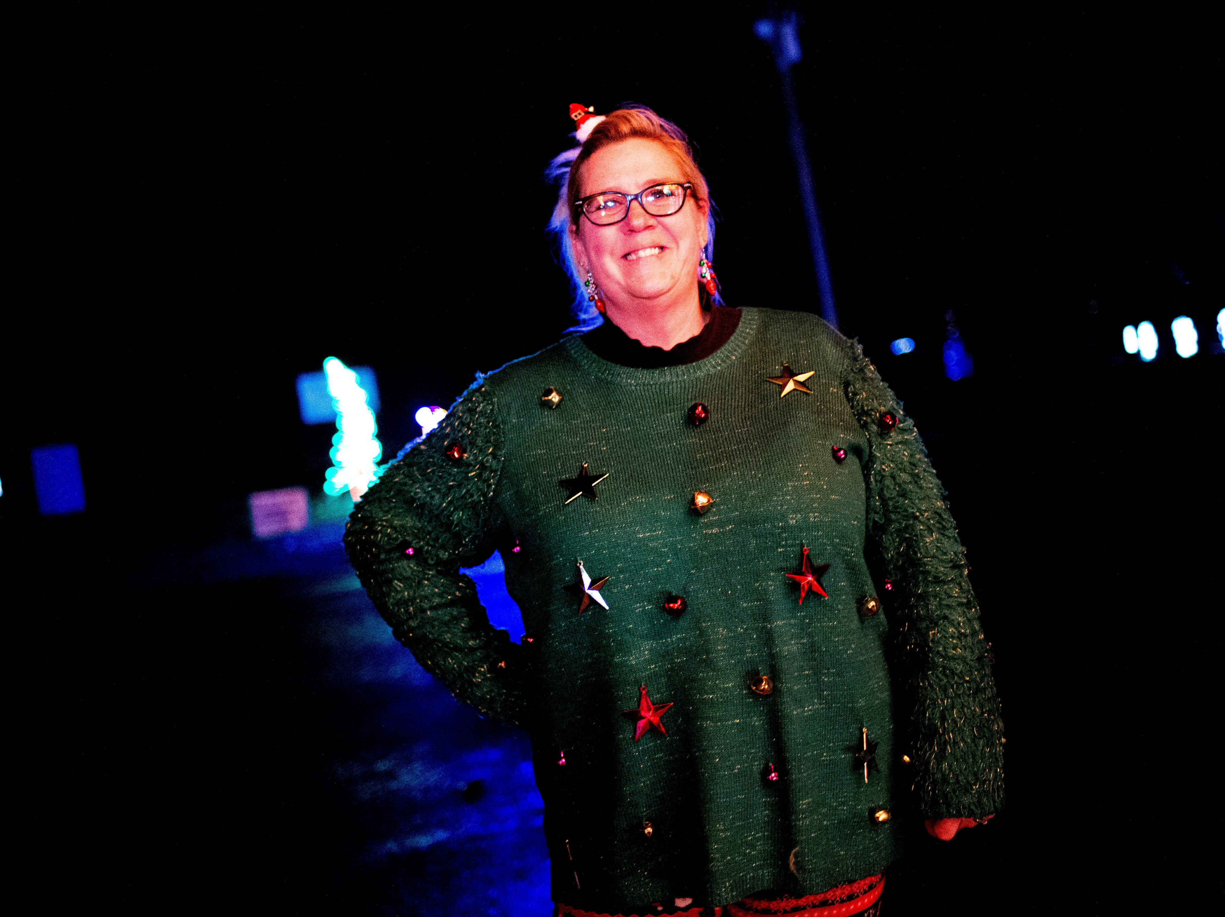 Melanie Millsaps, of Maryville, poses with her Christmas gear at Knox CountyÕs 20th annual Holiday Festival of Lights kick off at The Cove at Concord Park in Farragut, Tennessee on Friday, December 21, 2018. The family-friendly event is free and will run through Dec. 29 from 6 to 9 p.m., excluding Christmas Eve and Christmas Day.