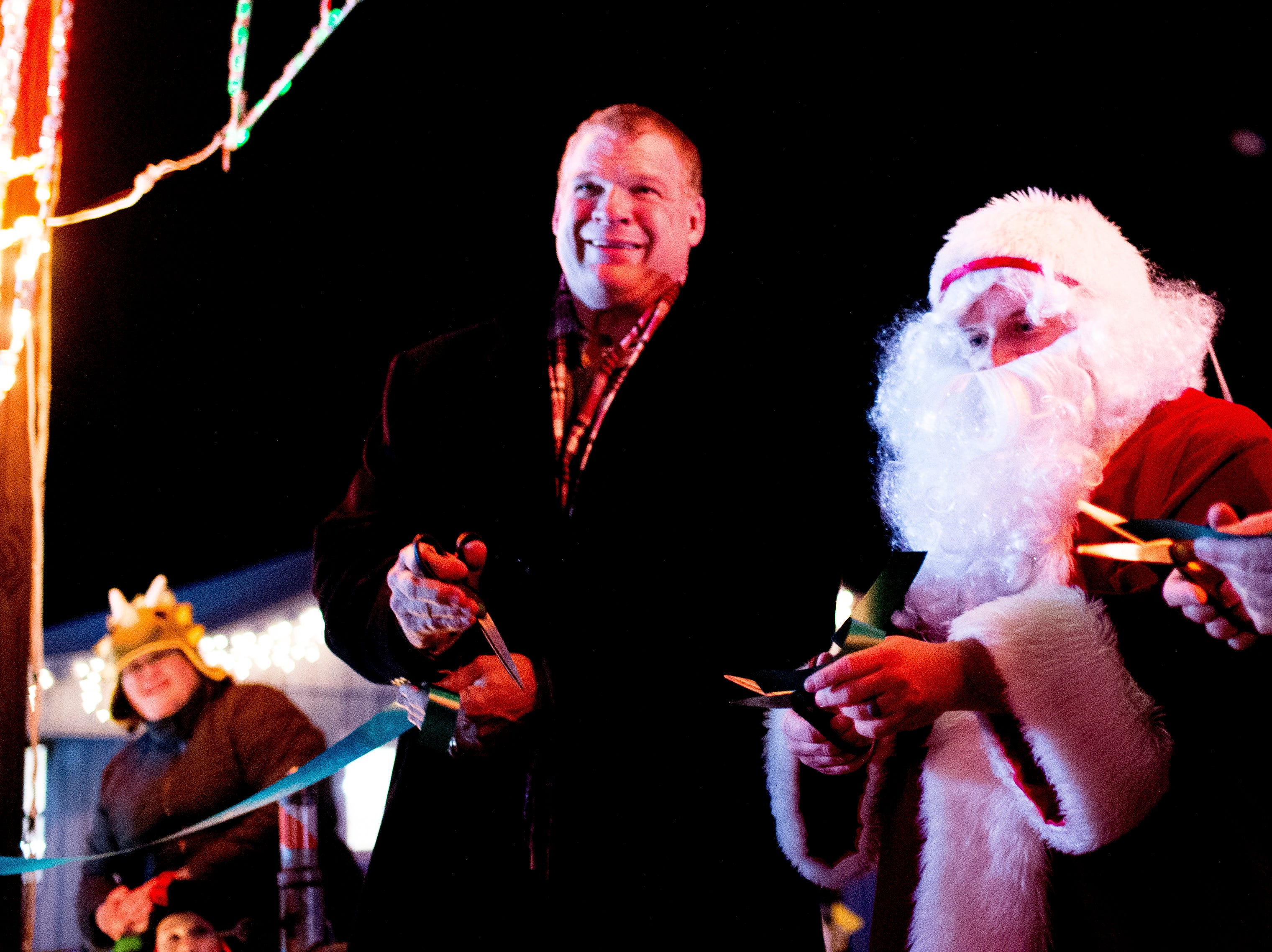 From left, Knox County Mayor Glenn Jacobs, Santa Claus and at Knox CountyÕs 20th annual Holiday Festival of Lights kick off at The Cove at Concord Park in Farragut, Tennessee on Friday, December 21, 2018. The family-friendly event is free and will run through Dec. 29 from 6 to 9 p.m., excluding Christmas Eve and Christmas Day.