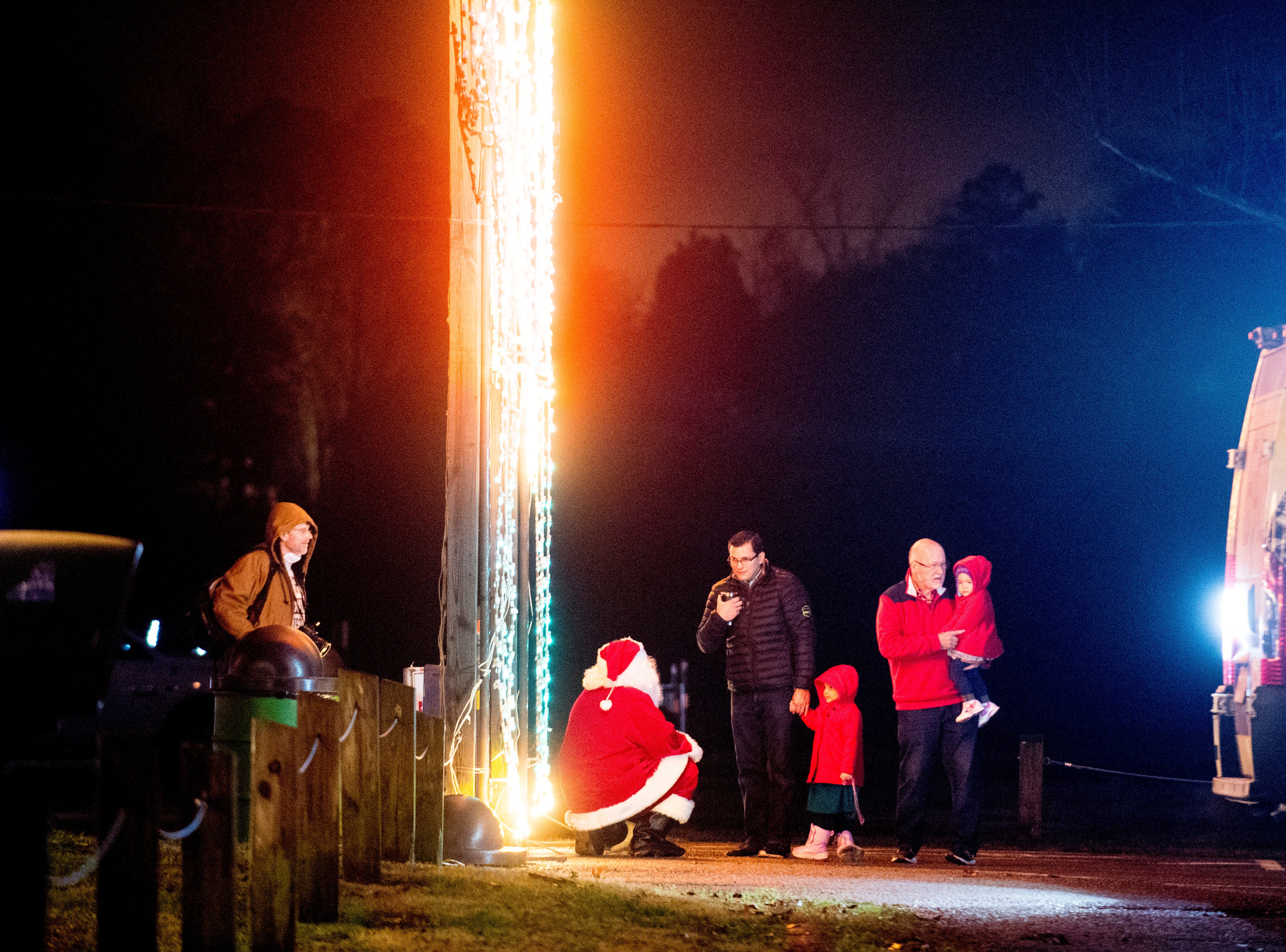 Santa Claus greets visitors at Knox CountyÕs 20th annual Holiday Festival of Lights kick off at The Cove at Concord Park in Farragut, Tennessee on Friday, December 21, 2018. The family-friendly event is free and will run through Dec. 29 from 6 to 9 p.m., excluding Christmas Eve and Christmas Day.
