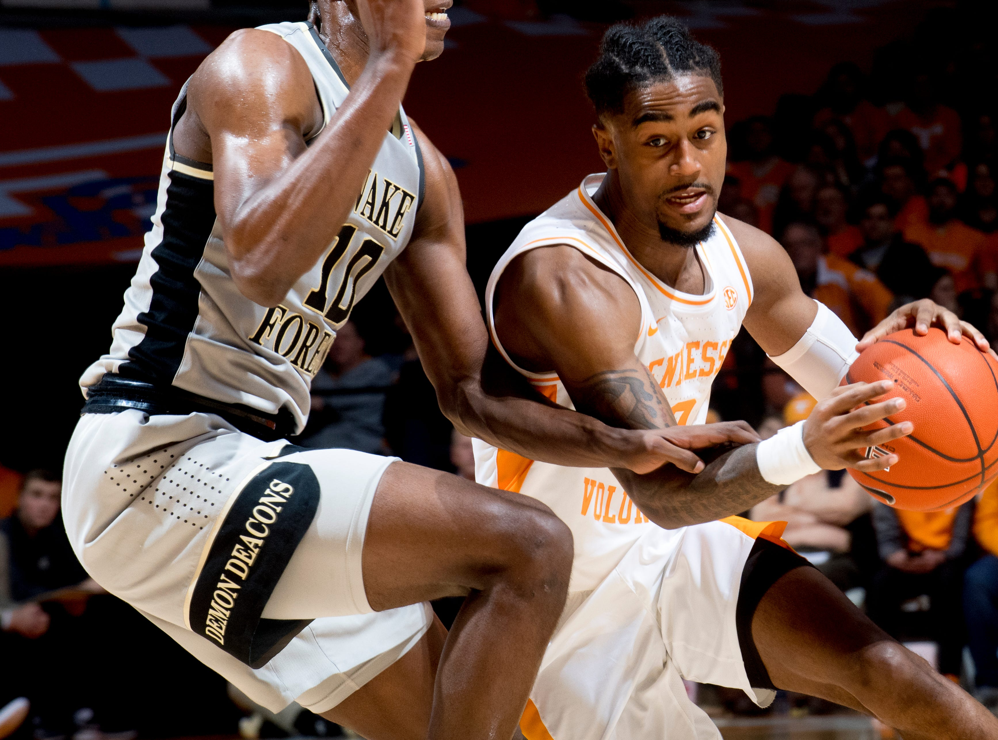 Tennessee guard Jordan Bone (0) dribbles past Wake Forest forward Jaylen Hoard (10) during a game between Tennessee and Wake Forest at Thompson-Boling Arena in Knoxville, Tennessee on Saturday, December 22, 2018.
