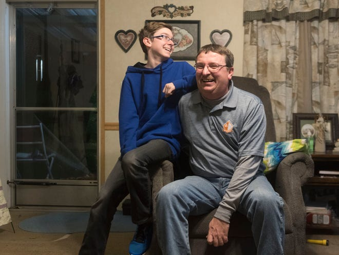 """Randy """"Rooster"""" Atkins and son Nathan at their home in Bean Station on Monday, December 10, 2018."""