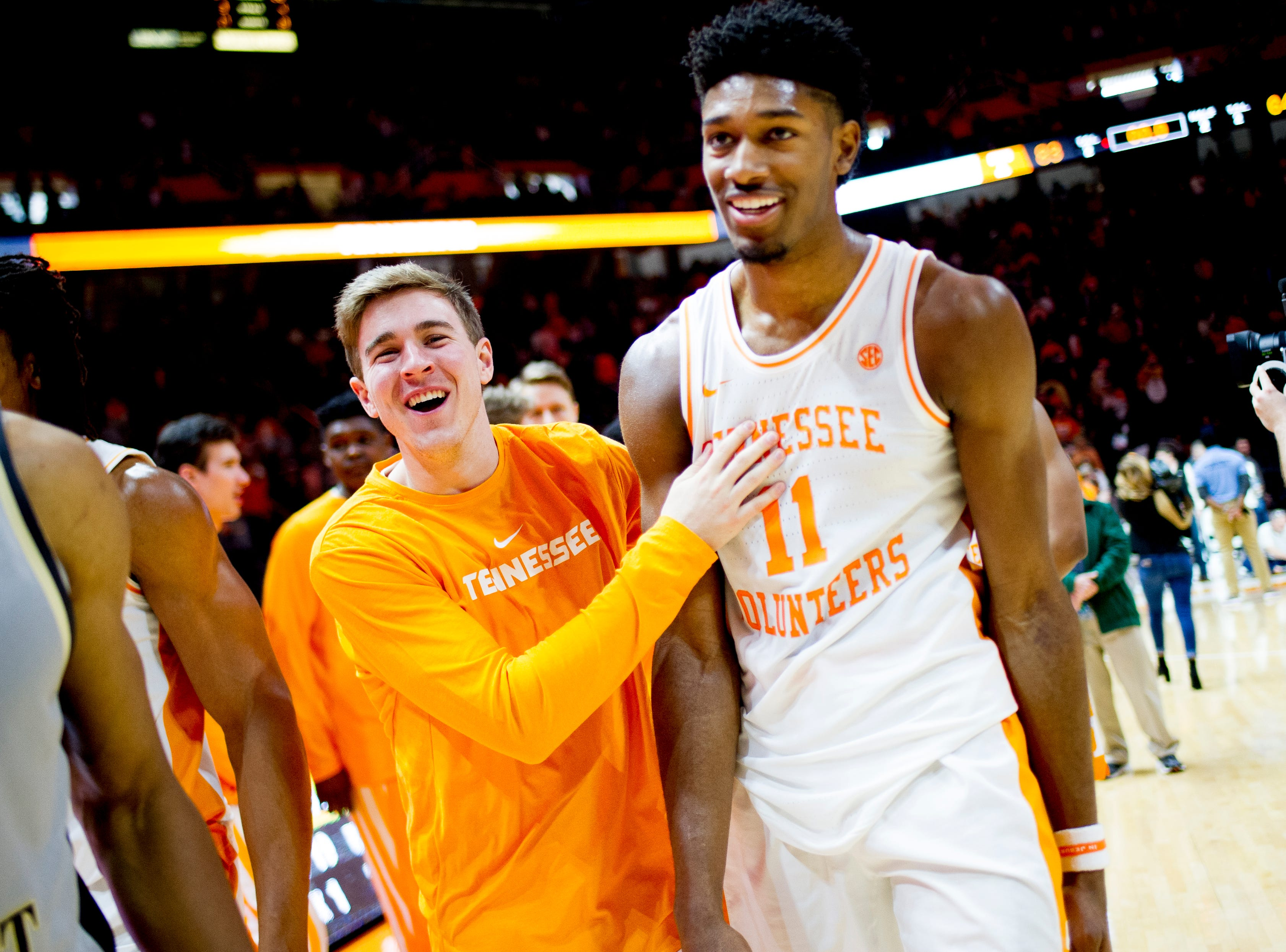Tennessee forward Kyle Alexander (11) and Tennessee guard Brad Woodson (12) celebrate their 83-64 win over Wake Forest at Thompson-Boling Arena in Knoxville, Tennessee on Saturday, December 22, 2018.