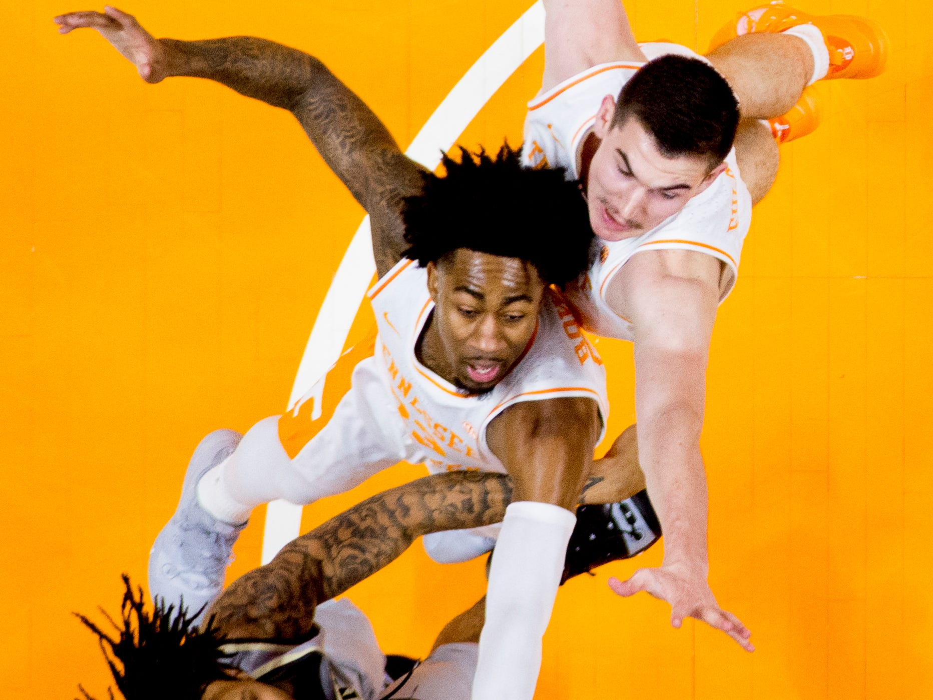 Tennessee guard Jordan Bowden (23) and Tennessee forward Kyle Alexander (11) defend against Wake Forest guard Sharon Wright Jr. (2) during a game between Tennessee and Wake Forest at Thompson-Boling Arena in Knoxville, Tennessee on Saturday, December 22, 2018.