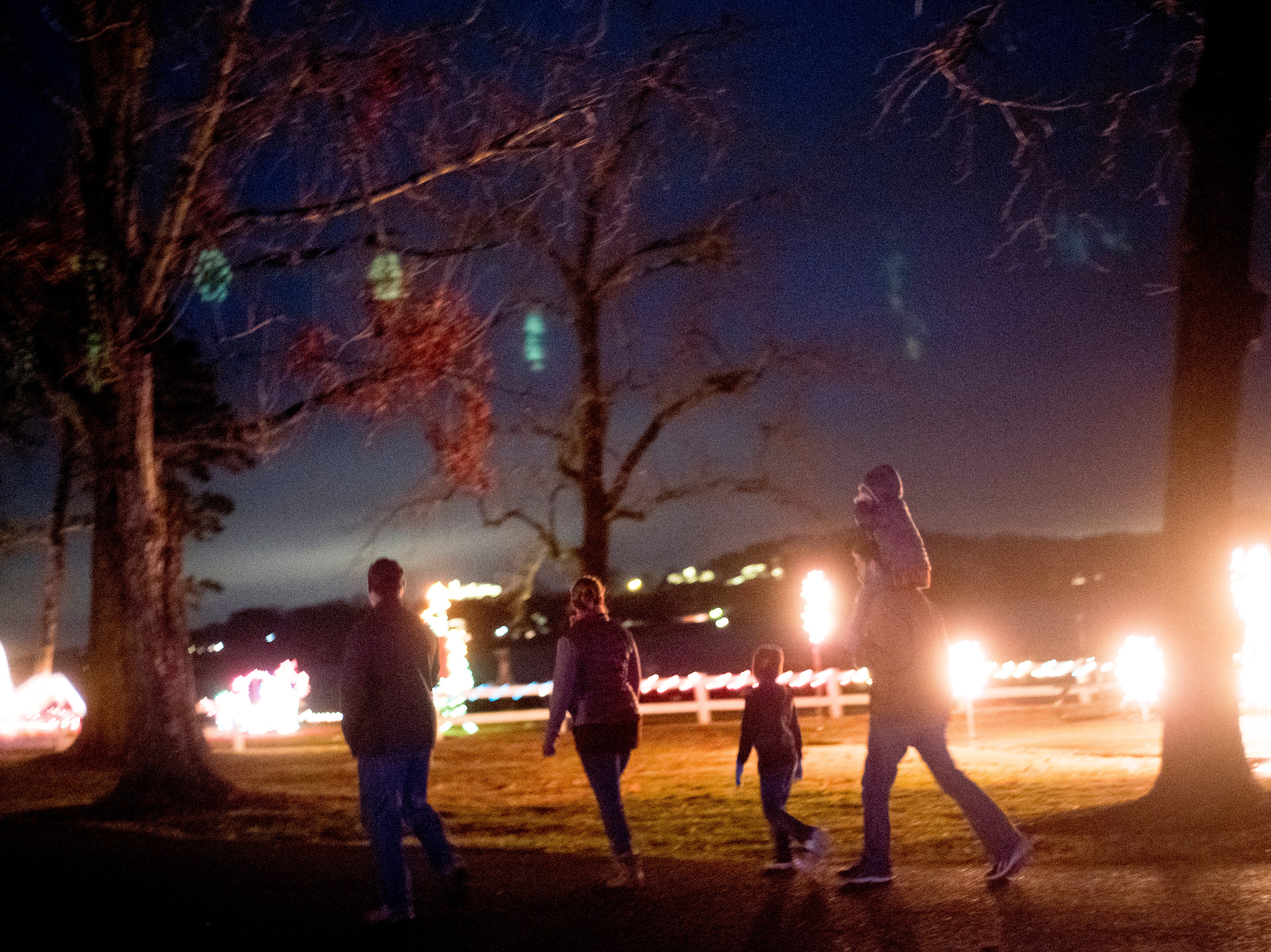 Visitors walk along a path at Knox CountyÕs 20th annual Holiday Festival of Lights kick off at The Cove at Concord Park in Farragut, Tennessee on Friday, December 21, 2018. The family-friendly event is free and will run through Dec. 29 from 6 to 9 p.m., excluding Christmas Eve and Christmas Day.