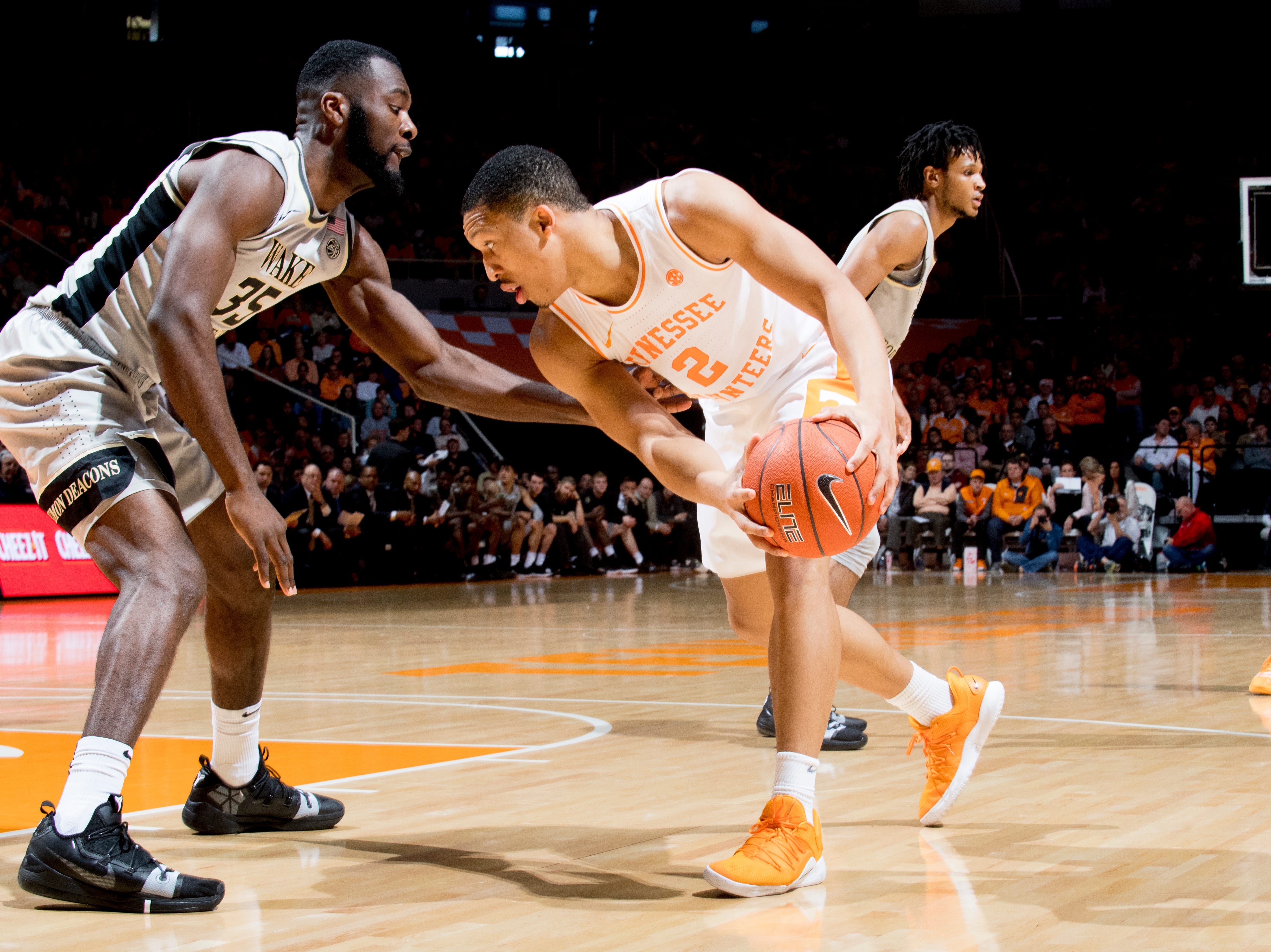 Tennessee forward Grant Williams (2) looks for a way around Wake Forest forward Ikenna Smart (35) during a game between Tennessee and Wake Forest at Thompson-Boling Arena in Knoxville, Tennessee on Saturday, December 22, 2018.