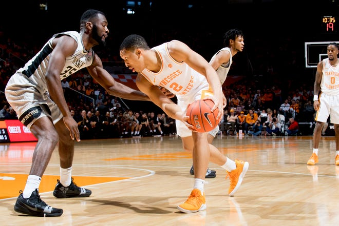 Tennessee forward Grant Williams (2) looks for a way around Wake Forest forward Ikenna Smart (35) during Saturday's game.