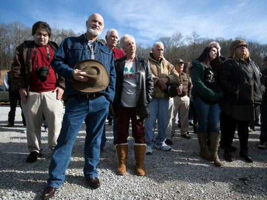 Relief workers of the TVA Kingston Fossil Fuel Power Plant coal ash spill gather in a memorial service on Saturday, December 22, 2018 to honor the more than 30 disaster workers are dead and more than 250 others are sick or dying. The day marked the 10th anniversary of the spill.
