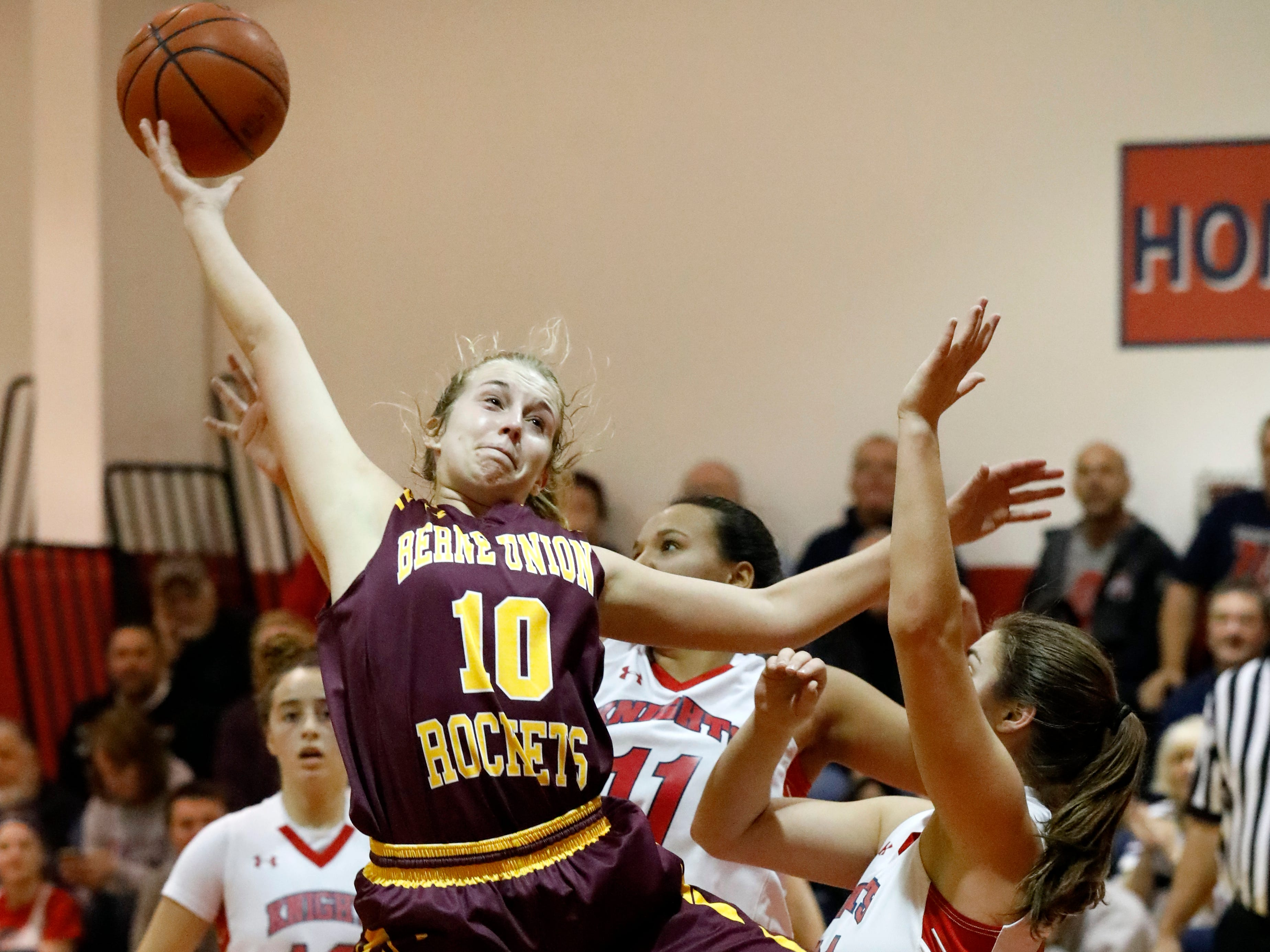 Berne Union's Lauren Nemeth grabs a rebound during Friday night's game, Dec. 21, 2018, against Fairfield Christian at Fairfield Christian Academy in Lancaster. The Knights defeated the Rockets 53-38.