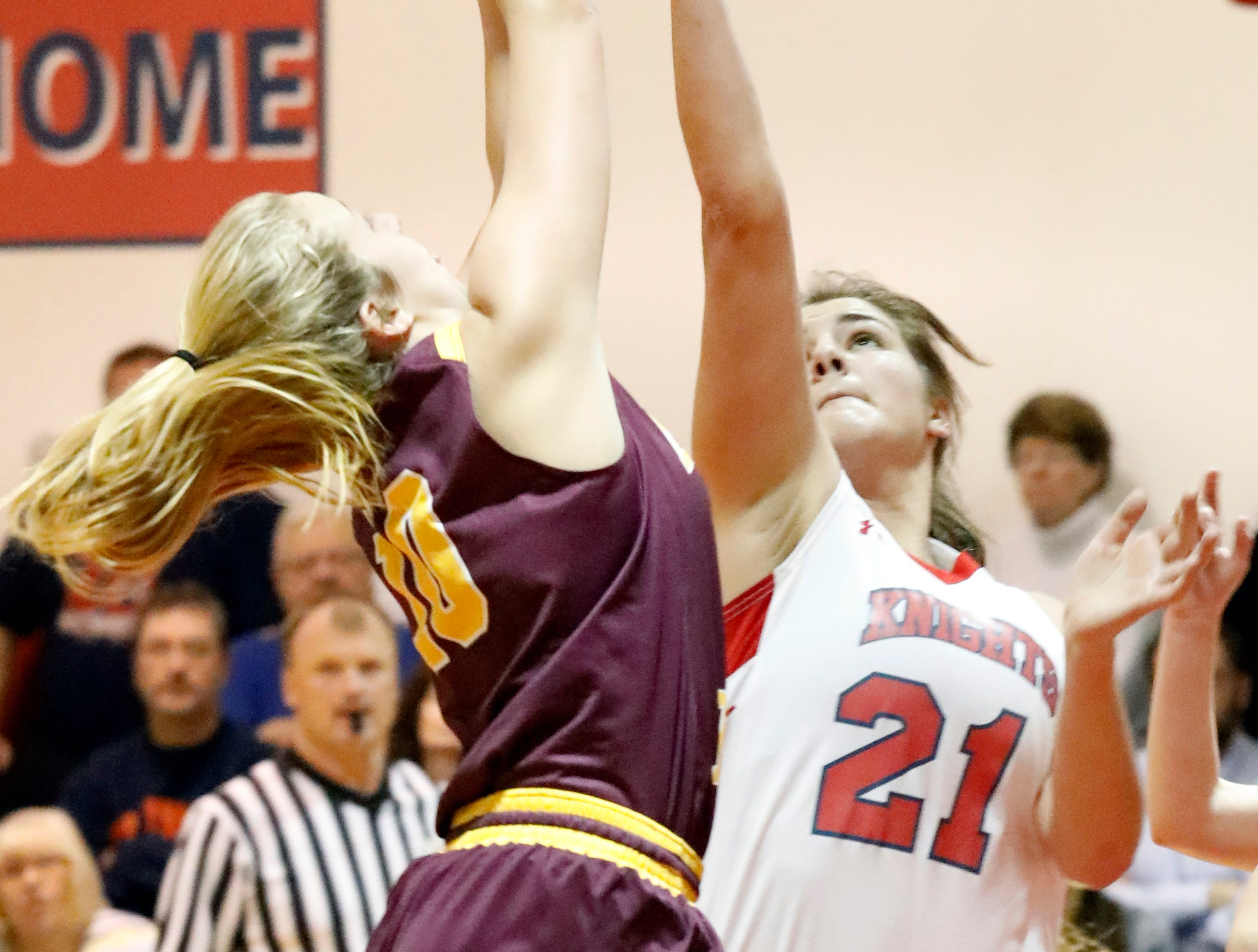 Berne Union's Lauren Nemeth, left, and Fairfield Christian's Sophia Sterling fight for a rebound Friday night, Dec. 21, 2018, at Fairfield Christian Academy in Lancaster. The Knights defeated the Rockets 53-38.