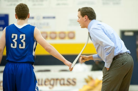 Walton Verona head basketball coach Grant M. Brannen yells instruction to Walton-Verona guard Grant Grubbs during the game.