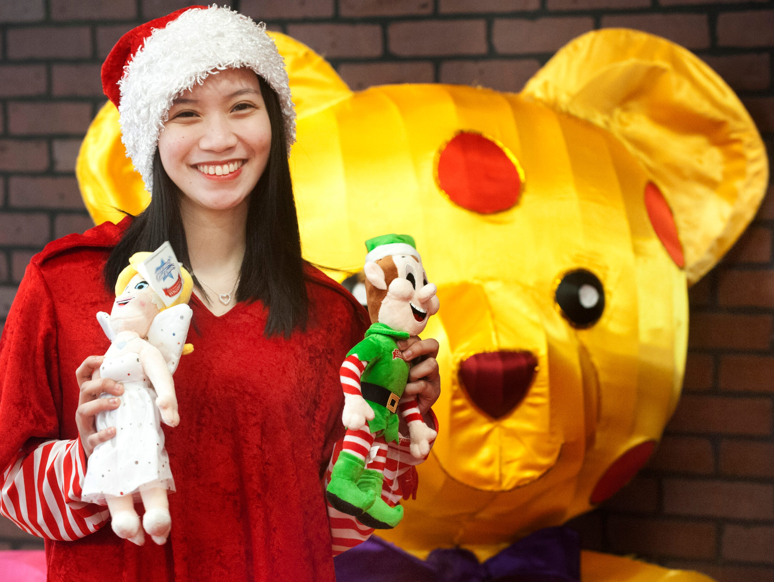 Santa's elf Marjorie Torres shows off male and female dolls in the Santa room. Everyone who visited with Santa got their choice of the female or male stuffed toy.22 December 2018