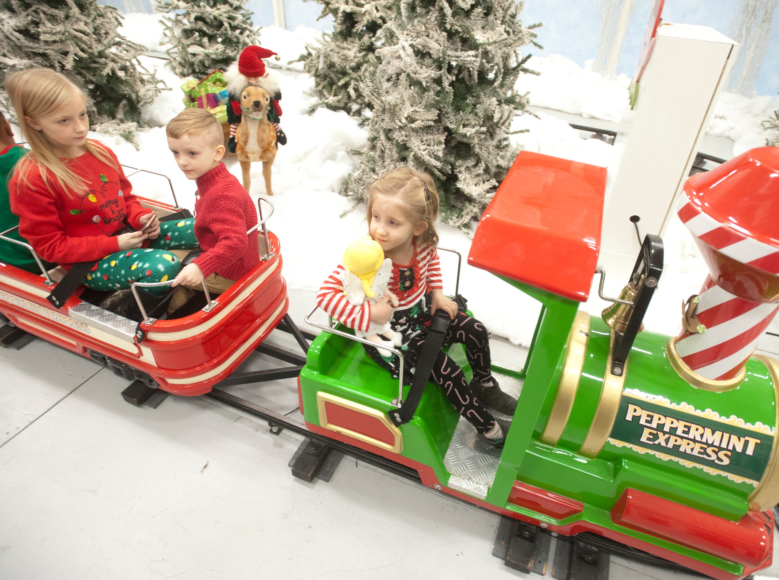 """Rayne Weber, age 4, of Eaton, OH., sits in the engineer's seat on the Peppermint Express train ride at the Galt House Hotel's sold-out event,  """"Breakfast with Santa."""" She was in town visiting her grandmother who lives in Jeffersonville.22 December 2018"""
