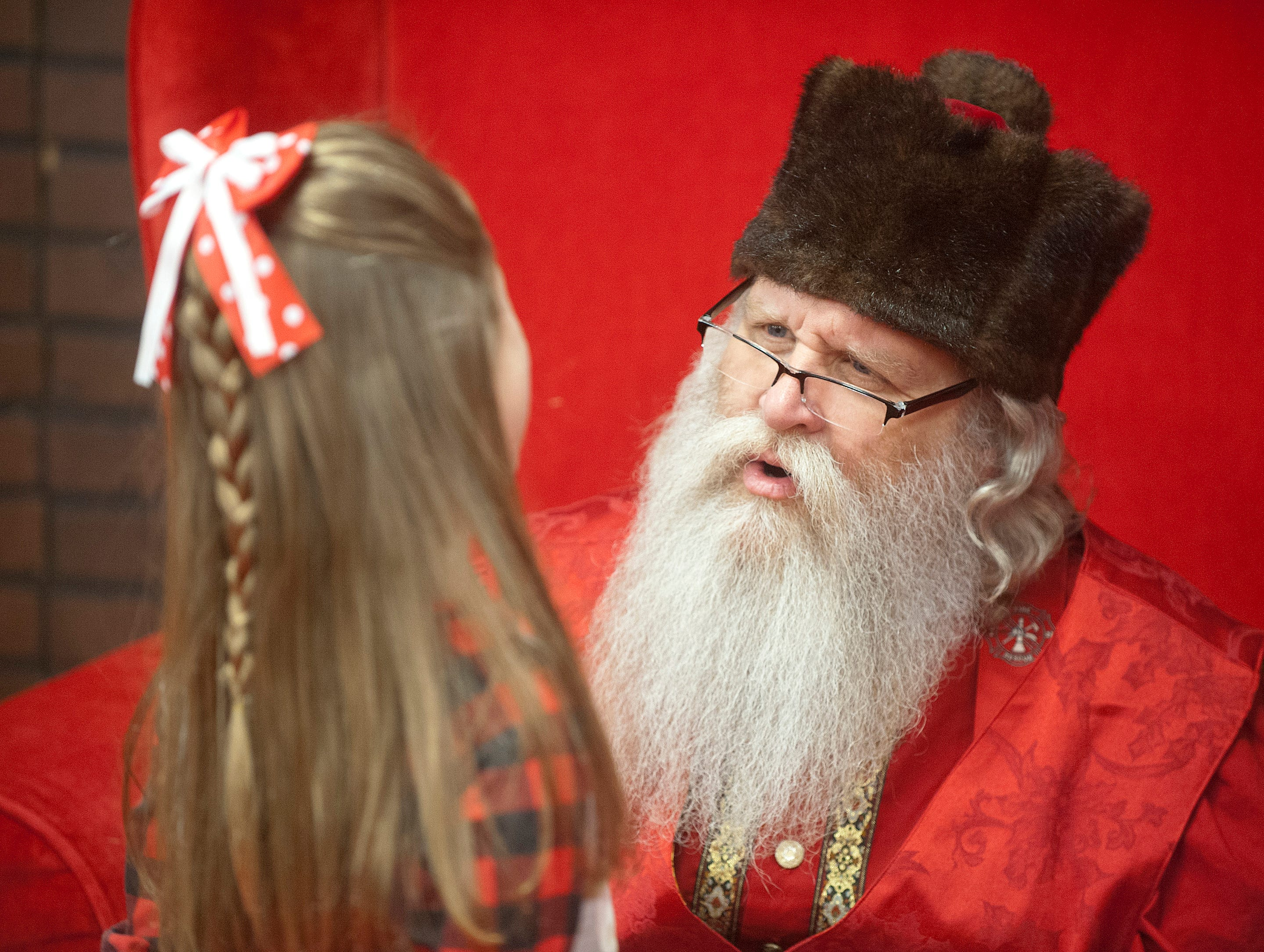 """Santa Claus (Murray McCandless) asks Marlee Montgomery of Frankfort,, Ky., what she wants for Christmas at the Galt House Hotel's sold-out event,  """"Breakfast with Santa.""""22 December 2018"""