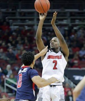 Louisville's Darius Perry takes a shot over Robert Morris' Josh Williams.